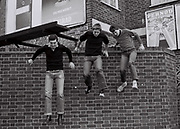 Teenagers jump from a brick wall, Greenford. London, UK, 1980s.