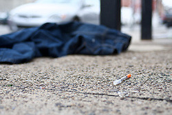 Unsanitary items like used syringes, worn clothes and human waste are found on sidewalks, between parked cars and near front doors on Jasper Street in the Kensington neighborhood in Philadelphia, PA, on March 26, 2018. (Bastiaan Slabbers for WHYY)