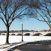 The Potomac running through Washington DC is frozen and covered with a layer of snow. The region has experienced an unusually cold winter, with sustained low temperatures.