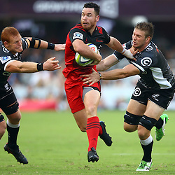 DURBAN, SOUTH AFRICA - MARCH 26: Ryan Crotty of the BNZ Crusaders gets past Phillip van der Walt and  Stephan Lewies of the Cell C Sharks during the Super Rugby match between Cell C Sharks and BNZ Crusaders at Growthpoint Kings Park on March 26, 2016 in Durban, South Africa. (Photo by Steve Haag)<br /> <br /> images for social media must have consent from Steve Haag