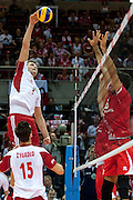 (L) Michal Winiarski from Poland attacks during the 2013 CEV VELUX Volleyball European Championship match between Poland and Turkey at Ergo Arena in Gdansk on September 20, 2013.<br /> <br /> Poland, Gdansk, September 20, 2013<br /> <br /> Picture also available in RAW (NEF) or TIFF format on special request.<br /> <br /> For editorial use only. Any commercial or promotional use requires permission.<br /> <br /> Mandatory credit:<br /> Photo by &copy; Adam Nurkiewicz / Mediasport