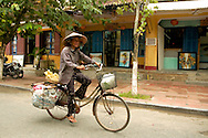 Vietnamese woman riding