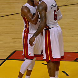 Jun 19, 2012; Miami, FL, USA; Miami Heat shooting guard Dwyane Wade (3) and small forward LeBron James (6) celebrate during the fourth quarter in game four in the 2012 NBA Finals against the Oklahoma City Thunder at the American Airlines Arena. Mandatory Credit: Derick E. Hingle-US PRESSWIRE