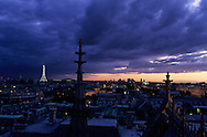 France. Paris. Elevated view on Paris cityscape and the Eiffel tower. Paris, the eiffel tower, the justice palace, the Seine river  . view from the Sainte Chapelle. Before to publish an image of the Eiffel tower lighting you should contact SETE; Mr Dieu at +33144112399 particularly for advertinsing.