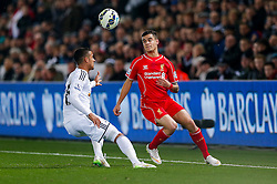 Philippe Coutinho of Liverpool is challenged by Kyle Naughton of Swansea City - Photo mandatory by-line: Rogan Thomson/JMP - 07966 386802 - 16/03/2015 - SPORT - FOOTBALL - Swansea, Wales — Liberty Stadium - Swansea City v Liverpool - Barclays Premier League.