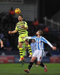 Yeovil Town's Joe Edwards wins a high ball. - Photo mandatory by-line: Alex James/JMP - Tel: Mobile: 07966 386802 29/12/2013 - SPORT - FOOTBALL - John Smith's Stadium - Huddersfield - Huddersfield Town v Yeovil Town - Sky Bet Championship