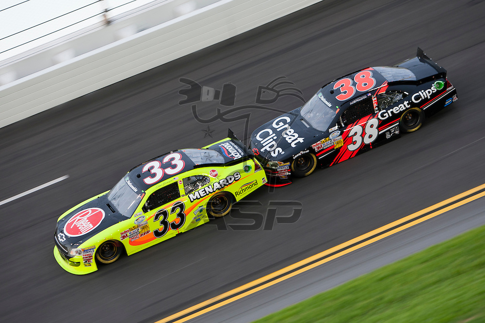 Daytona Beach, FL - July 01, 2011:  Clint Bowyer (33) and Jason Leffler (38) race off turn four during the Subway Jalapeno 250 at Daytona International Speedway in Daytona Beach, FL.
