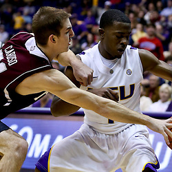 Jan 23, 2013; Baton Rouge, LA, USA; LSU Tigers guard Anthony Hickey (1) is defended by Texas A&M Aggies guard Alex Caruso (21) during the second half of a game at the Pete Maravich Assembly Center. LSU defeated Texas A&M 58-54. Mandatory Credit: Derick E. Hingle-USA TODAY Sports