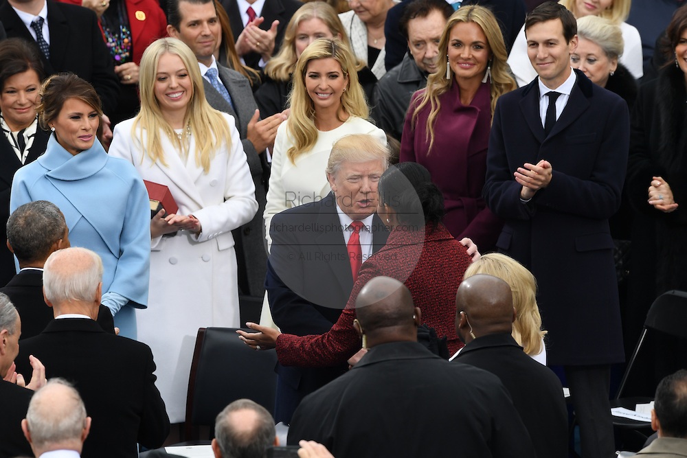 President-elect Donald Trump embraces First Lady Michelle Obama as he arrives for the swearing in ceremony as the 45th Presidential Inaugural Ceremony on Capitol Hill January 20, 2017 in Washington, DC.