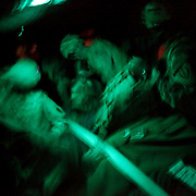 A long exposure shows soldiers strapping down rucksacks in a chinook helicopter on Jalalabad Airfield Afghanistan.