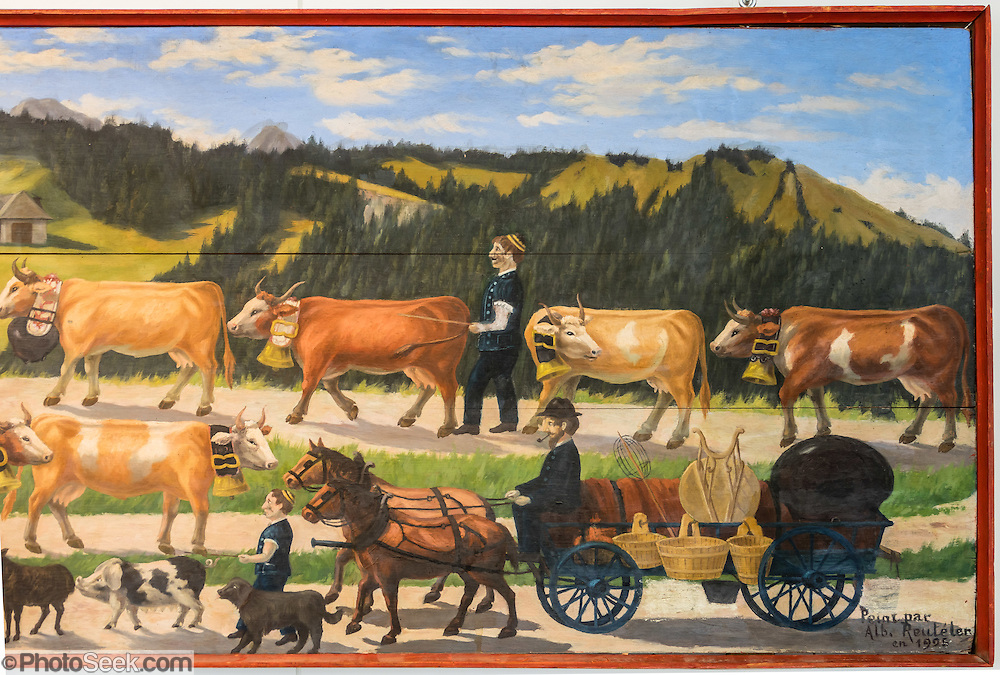 Painting of the traditional Swiss autumn cattle parade (by Alb. Reuteler in 1925) , a festive descent from alpine pastures. In this living tradition, cows are adorned with flowers and bells ring festively as the farmers walk alongside in their finest traditional costumes. Appenzell Museum, which is in the town hall, shows a cross section of the Swiss Canton's history and culture. Appenzell village is in Appenzell Innerrhoden, Switzerland's most traditional and smallest-population canton (second smallest by area).