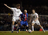 Photo: Jed Wee.<br /> Leeds United v Crystal Palace. Coca Cola Championship. 21/03/2006.<br /> <br /> Crystal Palace's Andy Johnson (C) shields the ball from Leeds' Eirik Bakke.