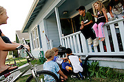 From left, Tracy Arnold, 11, Ryan Niewinski, 8, Chayse Sutherland, 7, Drake Hall, 11, Macey Sutherland, 4, and Mackenzie Hall, 4, hang out in Scotia, CA on Tuesday June 27, 2006. The town of Scotia in Northern California is a company town owned by the Pacific Lumber Company (PALCO), but that will change as the company will begin to sell the town. (Photo by Max Whittaker for The New York Times)<br />