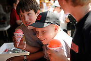 NEWS&GUIDE PHOTO / PRICE CHAMBERS.Ryder waits for a sno-cone at the Teton County Fair with friends Joey Caeser, left and Tony Moss, right.