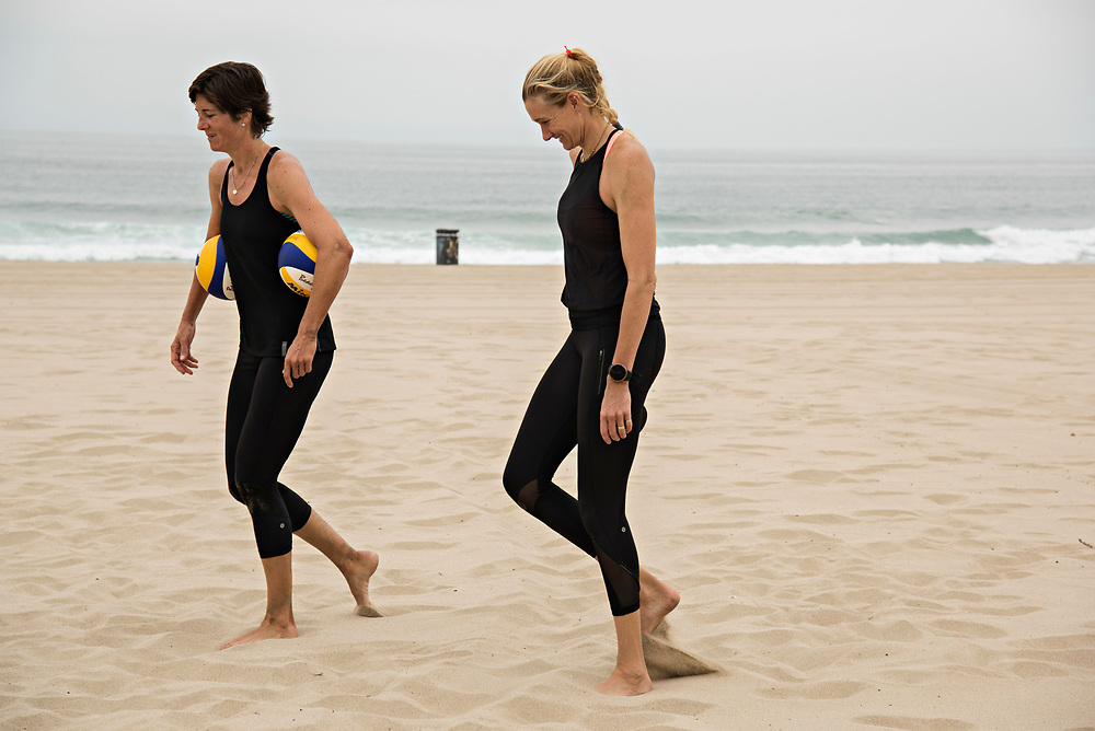MANHATTAN BEACH, CA - June 5, 2017:  <br /> <br /> Kerri Walsh Jennings, right, chats with her new partner Nicole Branagh on Manhattan Beach, while picking up volleyballs after practice.<br /> <br /> (photo by Melissa Lyttle for ESPN)