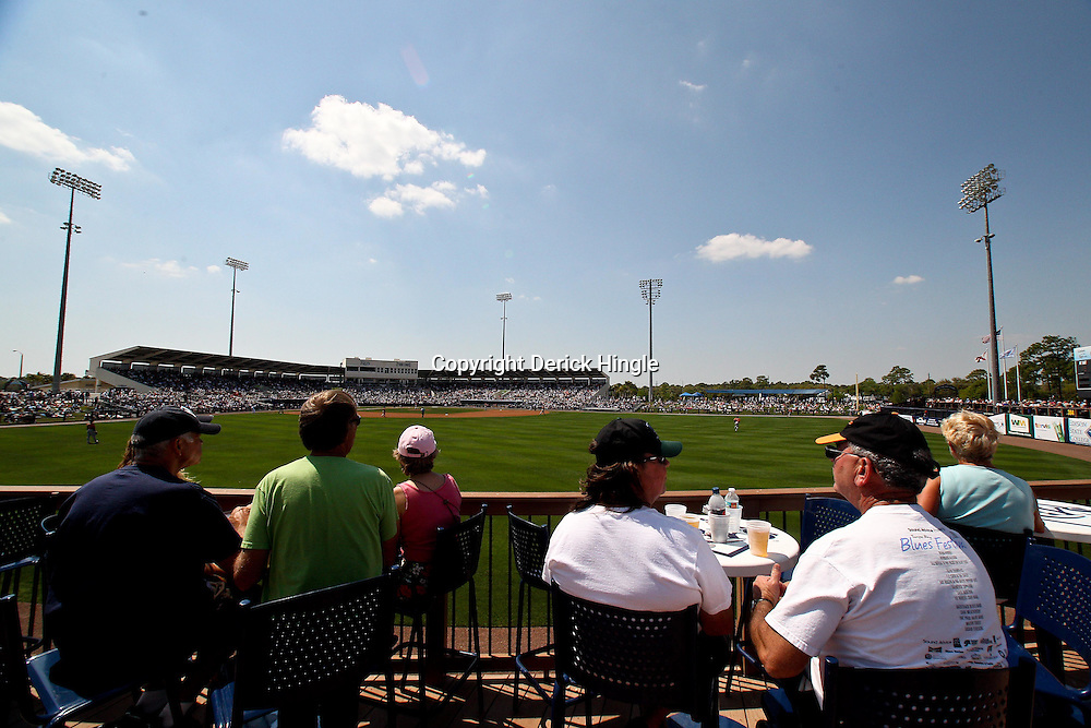 March 20, 2011; Port Charlotte, FL, USA; Fans watch from an outfield deck during a spring training exhibition game between the Baltimore Orioles and the Tampa Bay Rays at Charlotte Sports Park.   Mandatory Credit: Derick E. Hingle