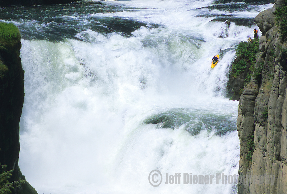 A whitewater kayaker paddles Lower Mesa Falls on the Henrys Fork of the Snake River, Idaho.