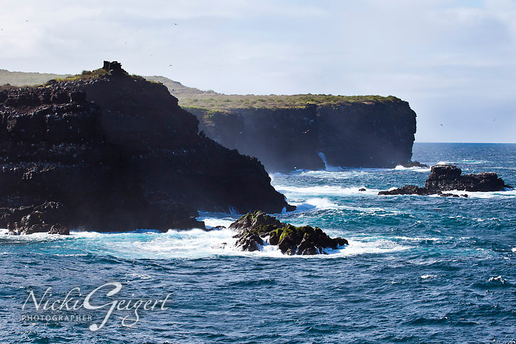 Dramatic seascape with waves breaking on rugged cliffs, blue ocean and sky. Landscape and nature photography prints for sale. Fine art photography wall art, stock images.