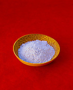 9900-1012 ~ Copyright:  George H. H. Huey ~ Blue cornmeal in a Hopi Indian bowl.  [Healthy, edible grain].