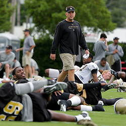 05 June 2009: Saints head coach Sean Payton walks among his players stretching during the New Orleans Saints Minicamp held at the team's practice facility in Metairie, Louisiana.