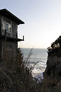 house on edge of rock on Enoshima island Japan