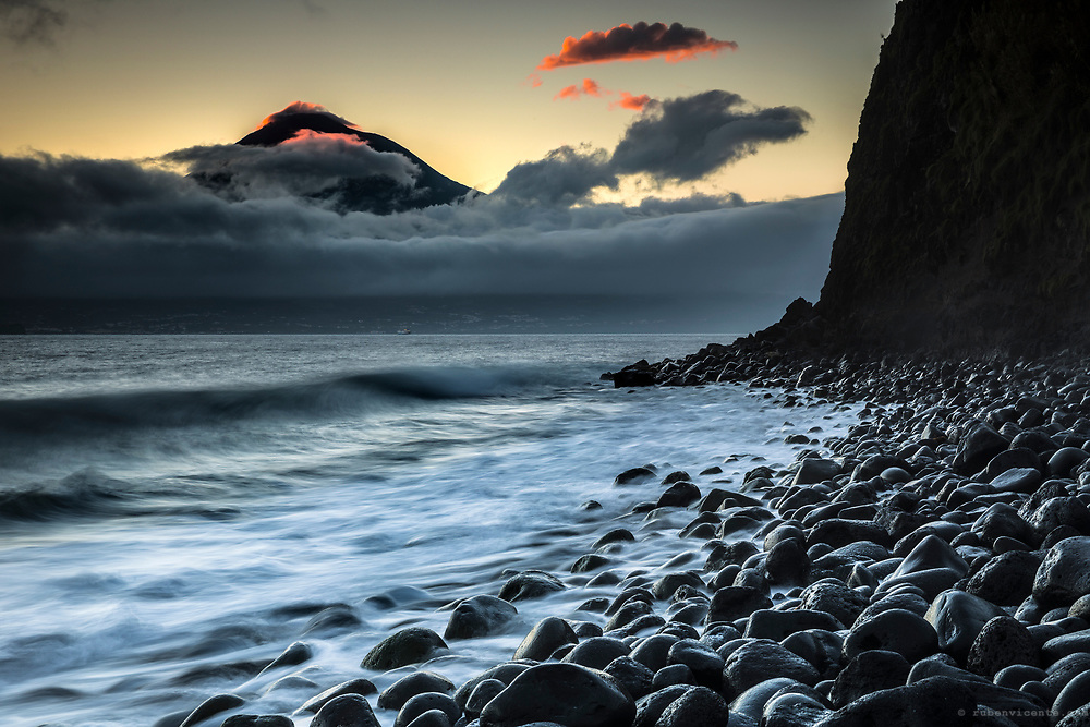 Sunrise at Praia do Almoxarife with a view over Pico. Faial, Azores, Portugal