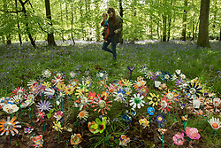 &copy; Licensed to London News Pictures. <br /> **EMBARGOED UNTIL 00.01am MONDAY 15 MAY, 2017**. 14/05/2017; Forest of Dean, Gloucestershire, UK. &quot;Please don&rsquo;t leaf it behind!&quot; Rosie Cripps with Ari Cussen (child) look at flowers made from rubbish collected in the Forest of Dean. The scheme is part of a new behaviour change campaign by Hubbub to tackle the rural litter epidemic. www.hubbub.org.uk/trashconverter. Trash Converters launch in the Forest of Dean, with a display of flowers created from waste, and with a van that gives out free drinks and snacks in exchange for rubbish that people find and bring to convert. For further details about the launch on 15 May please contact:<br /> Rachel Parkes	0777 565 2919 / rachel.parkes@greenhousepr.co.uk<br /> Helen Bell	07880 560 233 / helen.bell@greenhousepr.co.uk <br /> Picture credit : Simon Chapman/LNP