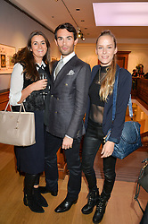Left to right, ROS CLARENCE-SMITH, MARK-FRANCIS VANDELLI and HUM FLEMING at a party to celebrate the publication of Capability Brown & Belvoir - Discovering a lost Landscape by The Duchess of Rutland, held at Christie's, 8 King Street, St.James, London on 7th October 2015.
