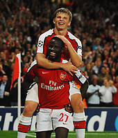 Football<br /> UEFA Champions League <br /> Arsenal v Olympiacos Fc at Emirates Stadium, London<br /> Andrel Arshavin celebrates his goal with Emmanuel Eboue<br />  29/09/2009 Credit Colorsport / Andy Cowie