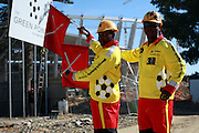 Workers at the Green Point Stadium in Capetown, venue for the World Cup 2010 in South Africa, worker in front of the Stadium