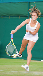 LONDON, ENGLAND - Wednesday, June 24, 2009: Michelle Larcher De Brito (POR) during her Ladies' Singles 2nd Round match on day three of the Wimbledon Lawn Tennis Championships at the All England Lawn Tennis and Croquet Club. (Pic by David Rawcliffe/Propaganda)