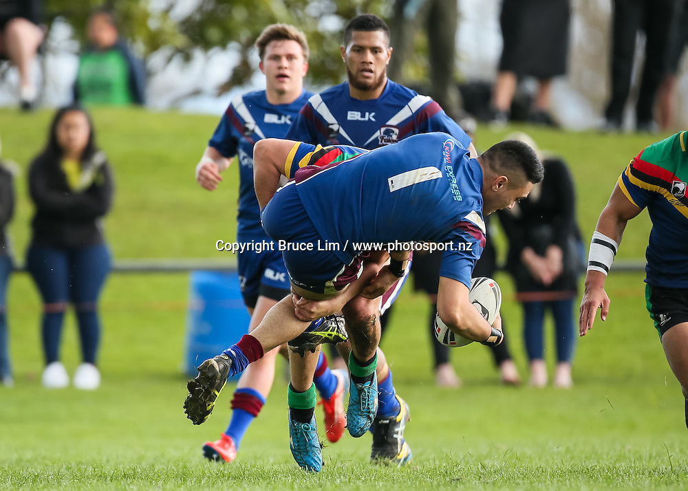 Akarana Falcons fullback Levi McBirney is tackled by Wai-Coa-Bay Stallions hooker Patrick Russell during the NZRL Premiership rugby league match - Wai-Coa-Bay Stallions v Akarana Falcons at Resthills Park, Hamilton on Saturday 19 September 2015. <br /> <br /> Copyright Photo:  Bruce Lim / www.photosport.nz