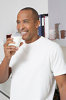 Man drinking milk in office
