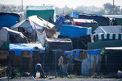 © Licensed to London News Pictures. 25/10/2016. Calais, France.  General view showing tented area at the migrant and refugee camp in Calais, known as the 'Jungle'. French authorities have moved thousands of refugees and migrants living at the makeshift living area on the French coast, with some still refusing to leave. . Photo credit: Ben Cawthra/LNP