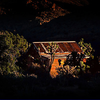 Art photography of one of the last mine cabins in  operation prior to the National Park Service assuming control of the Ivanpah Range as part of the Mojave National Preserve. up-thrust geologic formation along the Ivanpah Range of the Mojave National Preserve.