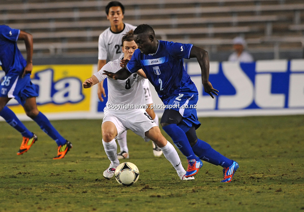 May 26, 2012: Honduras Wilmer Crisanto #2 fighting for the ball against New Zealand Michael Mcglinchey #8 during the game between the New Zealand and the Honduras at the Cotton Bowl Stadium in Dallas, Texas. New Zealand wins against Honduras, 1-0.