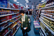 (MODEL RELEASED IMAGE). Ensada Dudo and her husband Rasim still shop at Sarajevo's traditional butcher shops and outdoor green markets, but they find this new, well-stocked supermarket an appealing one-stop shopping destination for lower prices and quality nonperishables. Hungry Planet: What the World Eats (p. 2-3).