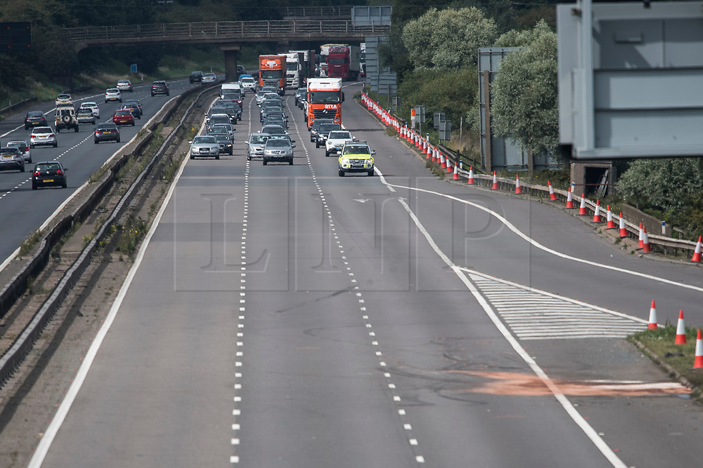 © Licensed to London News Pictures. 26/08/2017. Milton Keynes, UK. A police convoy leads traffic as the M1 motorway reopens at Milton Keynes, near the the scene of a crash involving a minibus and two lorries. Police say that several people are dead and four others have been taken to hospital after the accident on the southbound carriageway in the early hours of this morning. Photo credit: Ben Cawthra/LNP