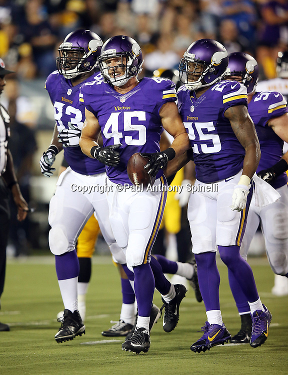 Minnesota Vikings linebacker Brian Peters (45) celebrates with teammates after intercepting a third quarter pass during the 2015 NFL Pro Football Hall of Fame preseason football game against the Pittsburgh Steelers on Sunday, Aug. 9, 2015 in Canton, Ohio. The Vikings won the game 14-3. (©Paul Anthony Spinelli)