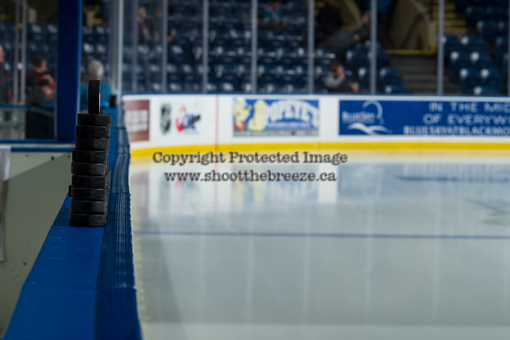 KELOWNA, CANADA - JANUARY 30: Pucks sit on the boards  on January 30, 2019 at Prospera Place in Kelowna, British Columbia, Canada.  (Photo by Marissa Baecker/Shoot the Breeze)