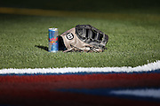 ANAHEIM, CA - JUNE 6:  A glove lies on the grass in the late day setting sun before the Chicago White Sox game against the Los Angeles Angels of Anaheim at Angel Stadium on Friday, June 6, 2014 in Anaheim, California. The Angels won the game 8-4. (Photo by Paul Spinelli/MLB Photos via Getty Images)