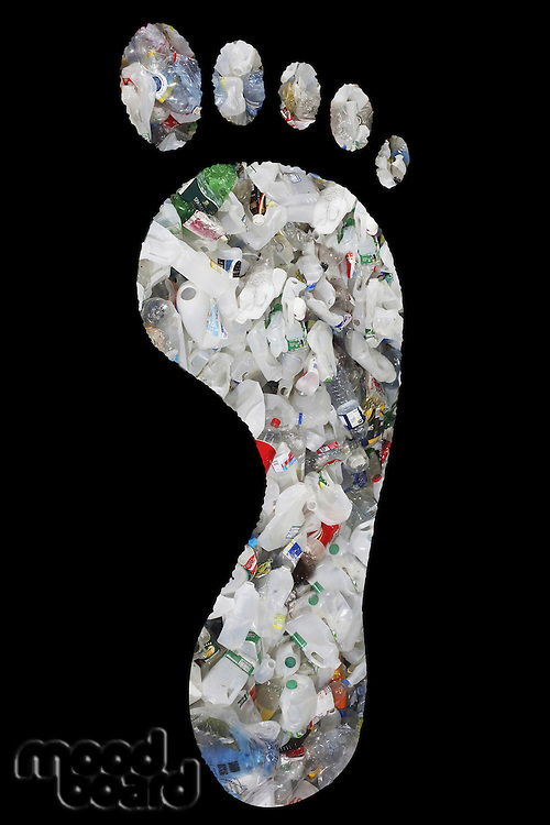 Pile of plastic bottles in footprints over black background