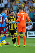 Burton Albion's Robbie Weir confronts Scunthorpe keeper Luke Daniels following a challenge on a team mate during the Sky Bet League 1 match between Burton Albion and Scunthorpe United at the Pirelli Stadium, Burton upon Trent, England on 8 August 2015. Photo by Aaron Lupton.