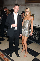WILLIAM AITKEN and PETRINA KHASHOGGI at Andy &amp; Patti Wong's annual Chinese New Year party, this year celebrating the year of the dog held at The Royal Courts of Justice, The Strand, London WC2 on 28th January 2006.<br />