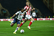 Preston North End midfielder Daniel Johnson (11) goes past Stoke City defender Liam Lindsay (5) during the EFL Sky Bet Championship match between Preston North End and Stoke City at Deepdale, Preston, England on 21 August 2019.