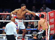 Picture by Alan Stanford/Focus Images Ltd +44 7915 056117<br />05/10/2013<br />Anthony Joshua knocks out Emanuele Leo in the first round during their Heavyweight Contest at the O2 Arena, London.