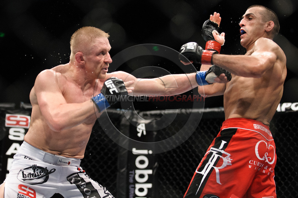 """SYDNEY, AUSTRALIA, FEBRUARY 27, 2011: Dennis Siver (lef) stuns George Sotiropoulos with a left jab during """"UFC 127: Penn vs. Fitch"""" inside Acer Arena in Sydney, Australia on February 27, 2011."""