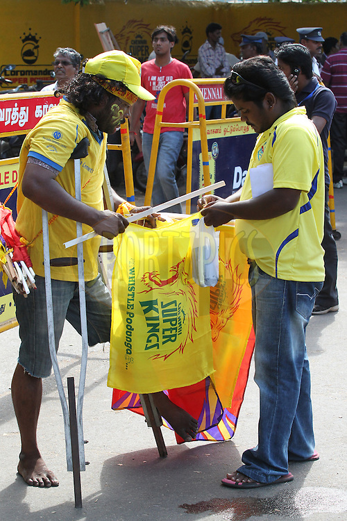 Road side vendor sales the CSK flag during match 13 of the the Indian Premier League ( IPL) 2012  between The Chennai Superkings and the Royal Challengers Bangalore held at the M. A. Chidambaram Stadium, Chennai on the 12th April 2012..Photo by Prashant Bhoot/IPL/SPORTZPICS