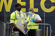 Stewards outside the ground before the Premier League match at Vicarage Road, Watford. Picture date: 20th June 2020. Picture credit should read: Darren Staples/Sportimage