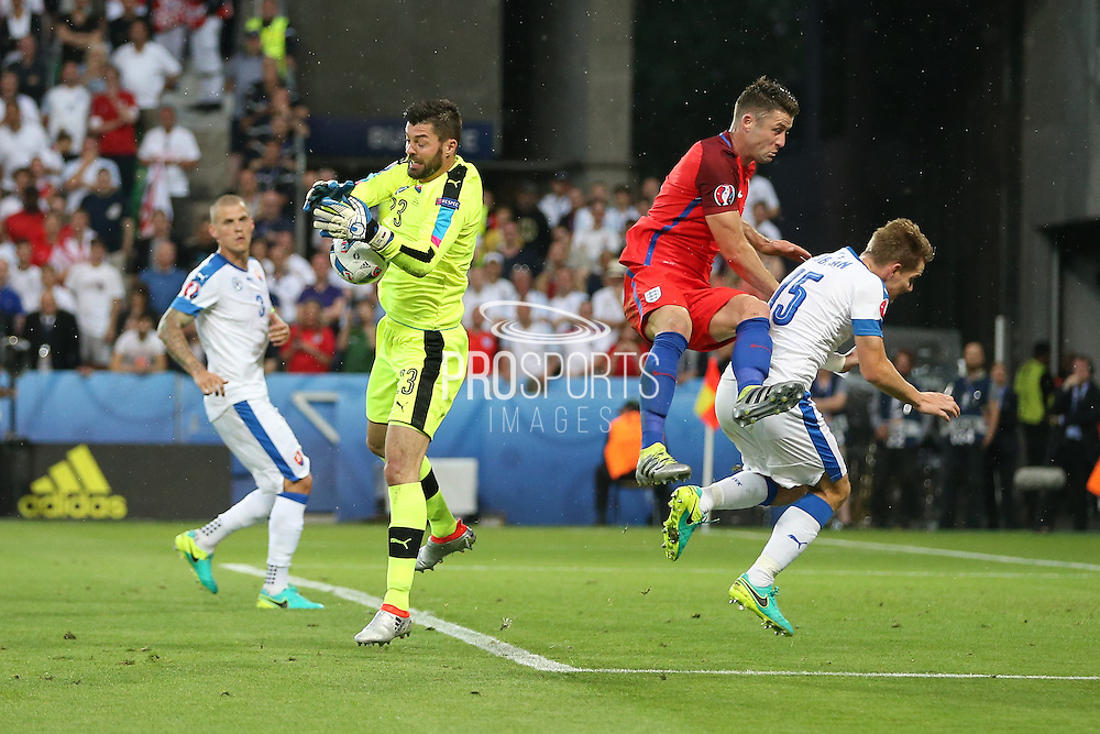 Slovakia Goalkeeper Matus Kozacik collects the ball from England Defender Gary Cahill during the Euro 2016 Group B match between Slovakia and England at Stade Geoffroy Guichard, Saint-Etienne, France on 20 June 2016. Photo by Phil Duncan.